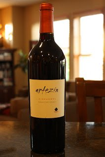 "91% Zinfandel, 8% Petite Sirah, 1% Carignan from Mendocino County, California. SRP of $18 and available as low as $13.99.  Sample received courtesy The Hess Collection for review purposes.  From the bottle: ""Artezin speaks classic varietal Zinfandel, with flavors of raspberry, pepper and spices. This wine is rich and supple with sweet tannins in the finish. An especially compatible wine with food, Artezin Zinfandel pairs well with grilled meats, pastas, and zesty cheeses. The wine is handcrafted from old vine, family-owned vineyards, located in the preeminent Zinfandel region of Mendocino County. Enjoy!  14.5% Alcohol"" The 2009 Artezin Mendocino County Zinfandel begins with nice strong aromas of plum, clove, spice, raspberry and pepper. The wine tastes of raspberry, black cherry, and plum plus some spice and pepper that balance the juicy fruit nicely. This is a rich and savory wine. The finish is slightly dry and medium-long and features a great combination of nice soft tannins and fruit flavors. This wine is quite good on its own and also shows lots of potential for pairing with food. I'd recommend this as a nice complement to a tomato based BBQ sauce.   Buy this wine online from our featured sponsor Marketview Liquor! See a listing of local retailers selling this wine here. Taste Rating: 8              Cost Rating: 6 Overall Rating: 7.5 Recommended Buy All ratings use a simple 10 point scale with 10 being the best. Find out more about my rating system here and check out the Interactive Wine Rating Chart to find all my reviews! You can sort by type of wine, cost, rating, etc. in the interactive spreadsheet.  1 Rating - Add Yours!"